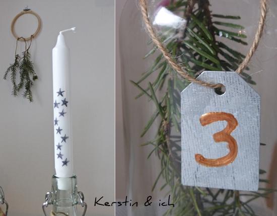 Adventskranz mit bemalten Kerzen und Tannenzweig in der Glasflasche