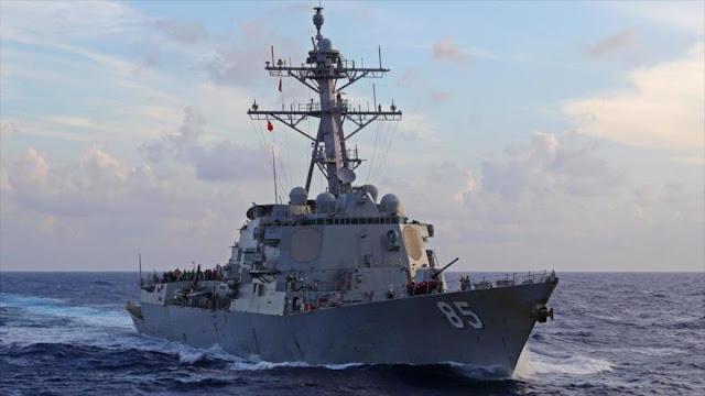 China expulsa un buque de guerra de EEUU de las aguas en disputa