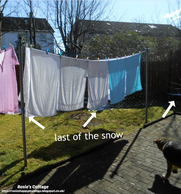 Pegging out laundry and ignoring what's left of the snow.