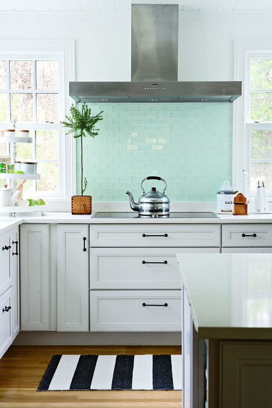 "Fresh turquoise glass tile splashback in this kitchen shot by Aimée Herring for ""The Happy Home Project"" book published by Filipacchi Publishing (via Houzz)."