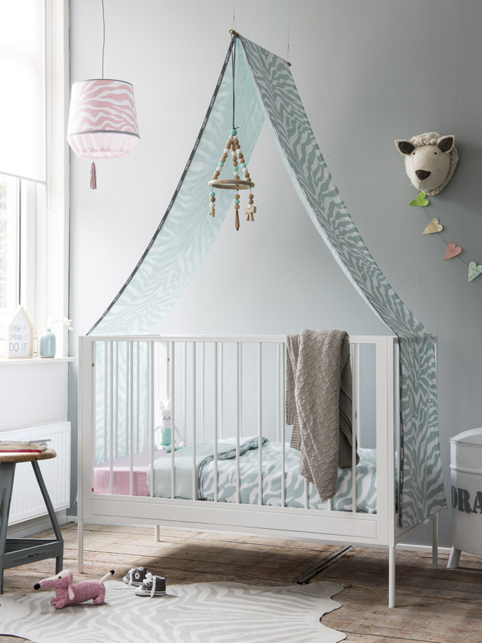 nursery room with blue and pink