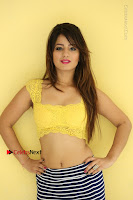 Cute Telugu Actress Shunaya Solanki High Definition Spicy Pos in Yellow Top and Skirt  0469.JPG