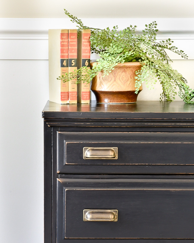 Gold pulls on black painted Goodwill dresser