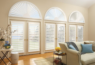 These Hunter Douglas NewStyle Shutters with Arch have a front tilt bar. Professional installation makes both the look and function work with the room.