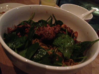 spicy sauasge over rice noodles with spinach