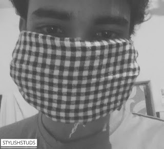 A guy wearing face mask which is made with bandana