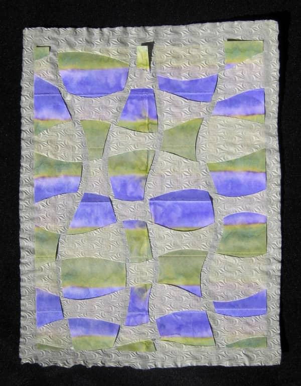 blue, green, and white rectangular paper weaving
