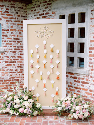 tall seating chart with flowers