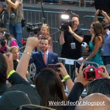 Chris Pine waving to the fans in the bleachers