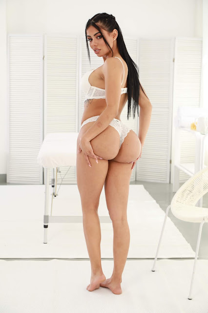 Canela Skin holding big sexy bubble butt in white lingerie
