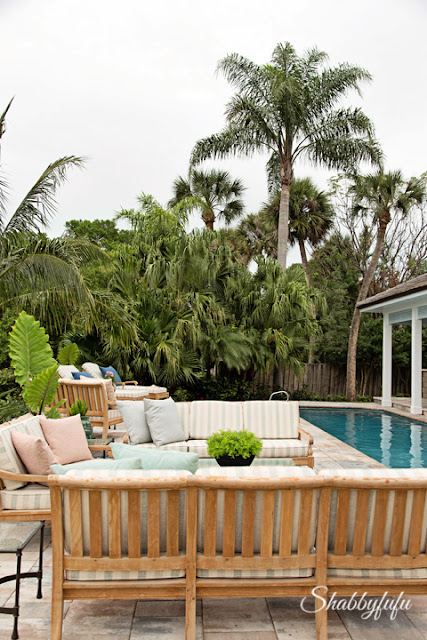 Landscaping and back yard furniture display around the pool area of the HGTV Dream Home 2016.