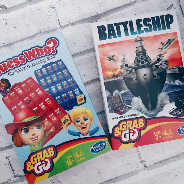 Flatlay showing two travel board games, GuessWho? and Battleships