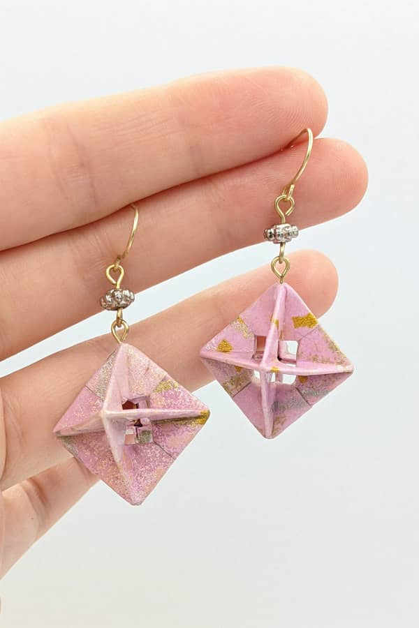 Pair of modular origami paper earrings in pink and silver