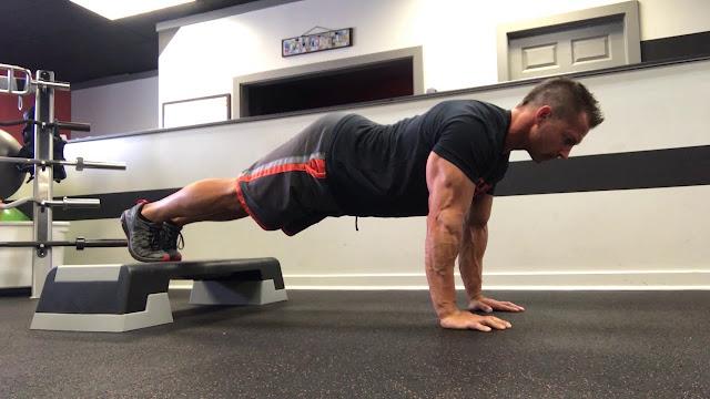 Feet-elevated plank