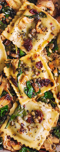 Mediterranean manner pasta recipe that d ITALIAN RAVIOLI WITH SPINACH, ARTICHOKES, CAPERS, SUN-DRIED TOMATOES