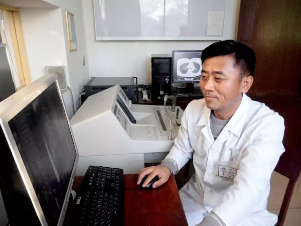 Kil Jong Chol, section chief of chest tumour laboratory of the Tumour Institute under the Academy of Medical Sciences, Pyongyang