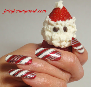 candy cane nail design with syrawberry santa