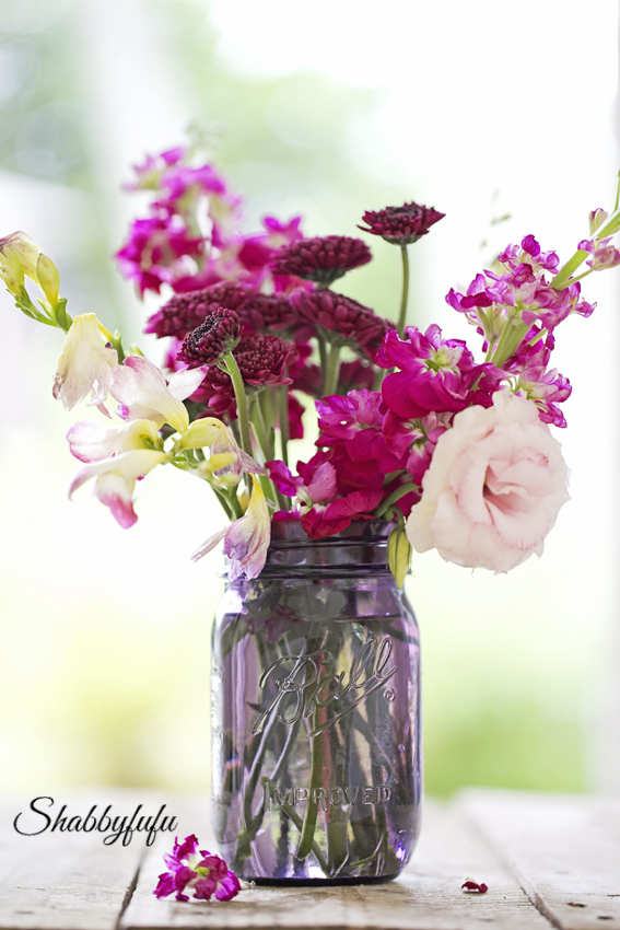purple mason jar with flowers