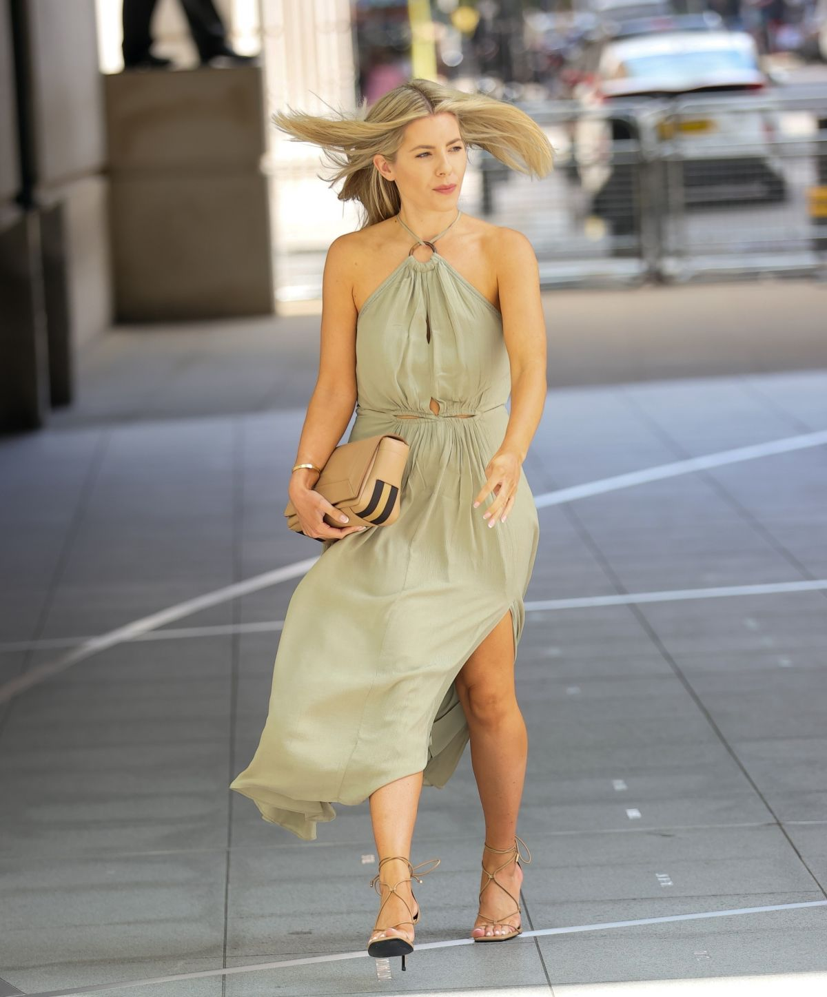 Mollie King bares bronzed legs out and about in khaki dress