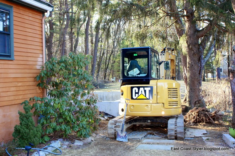 CAT excavator 1,000 sq. ft. home construction addition