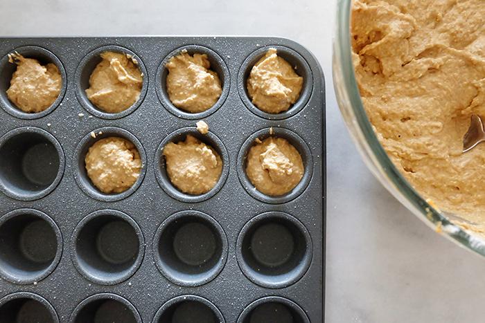 batter in mini muffin tin wells