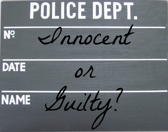 """Innocent or Guilty?"" text on police mugshot board background"