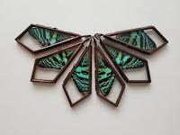 Butterfly wing pendant by Elemental Urchin.