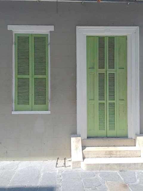 Shutter doors in pea green in New Orleans