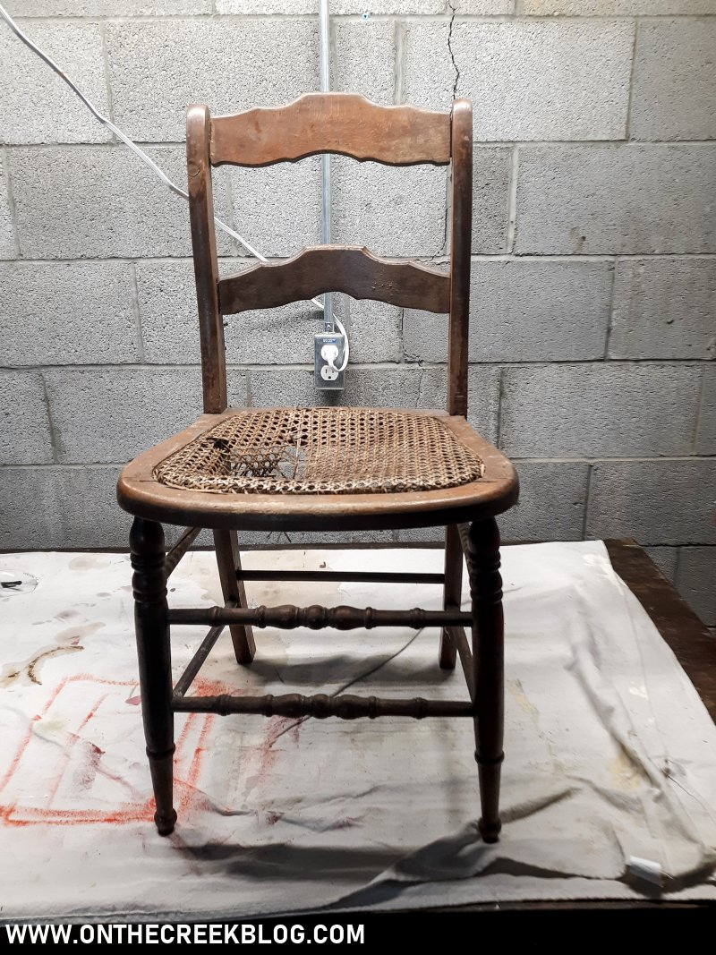 An old & busted chair gets a cute chippy makeover! | On The Creek Blog