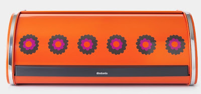 bread bin - orange with a row of brightly colored flowers, looking like something from the 1960s