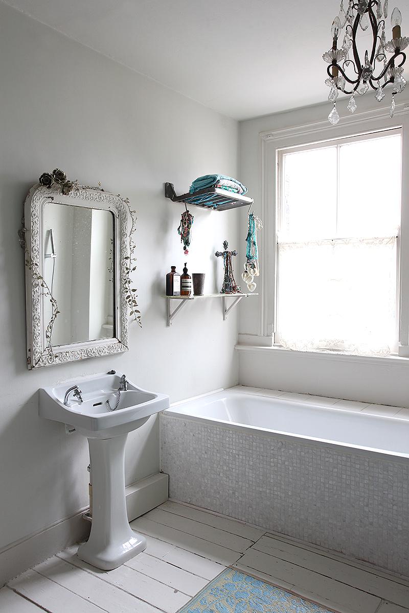 rustic bohemian bathroom, white painted floor, historic mirror