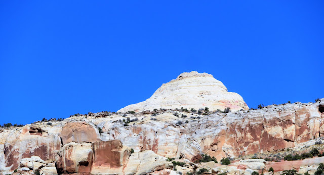 Image of white sandstone dome backed by blue sky.