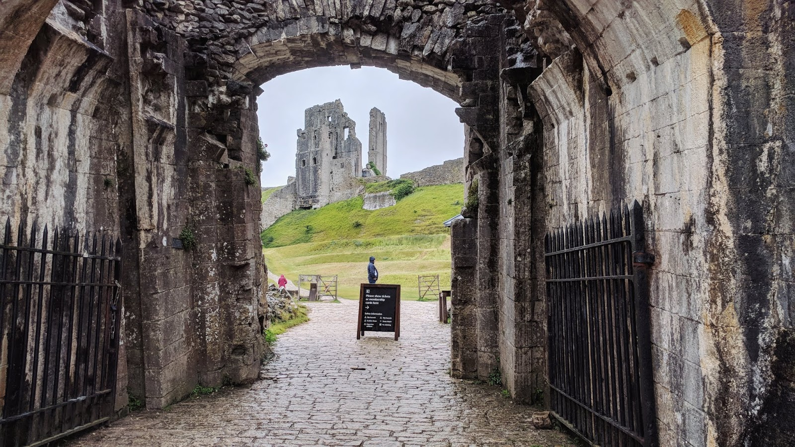 the entrance of Corfe Castle and the castle ruins