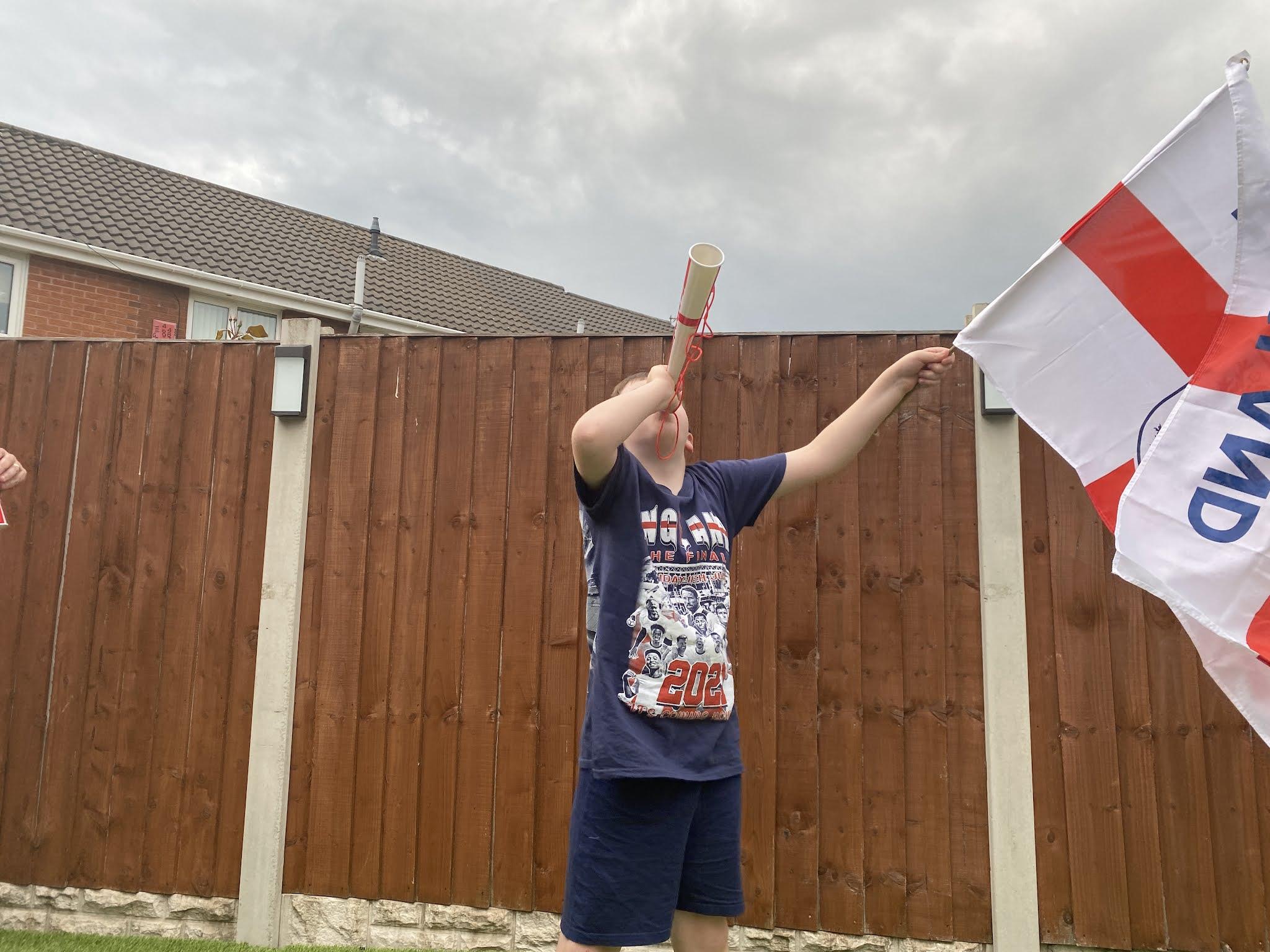 boy waving an england flag