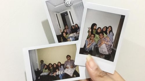 friends in polaroid photos