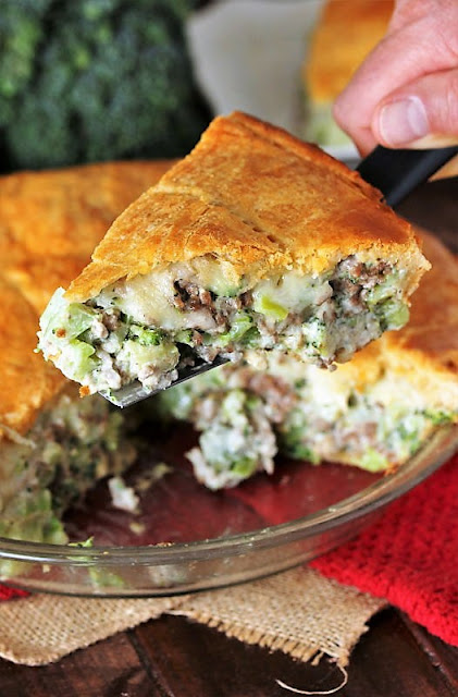 Serving a Piece of Ground Beef Broccoli Pie with Crescent Roll Crust Image