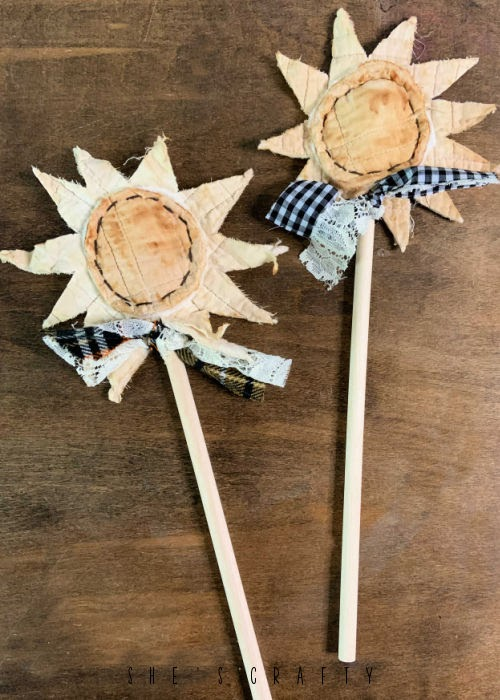 Tea Stained flowers on wooden dowels.