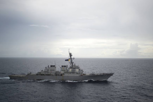 U.S. warship challenges Beijing's claims in disputed South China Sea