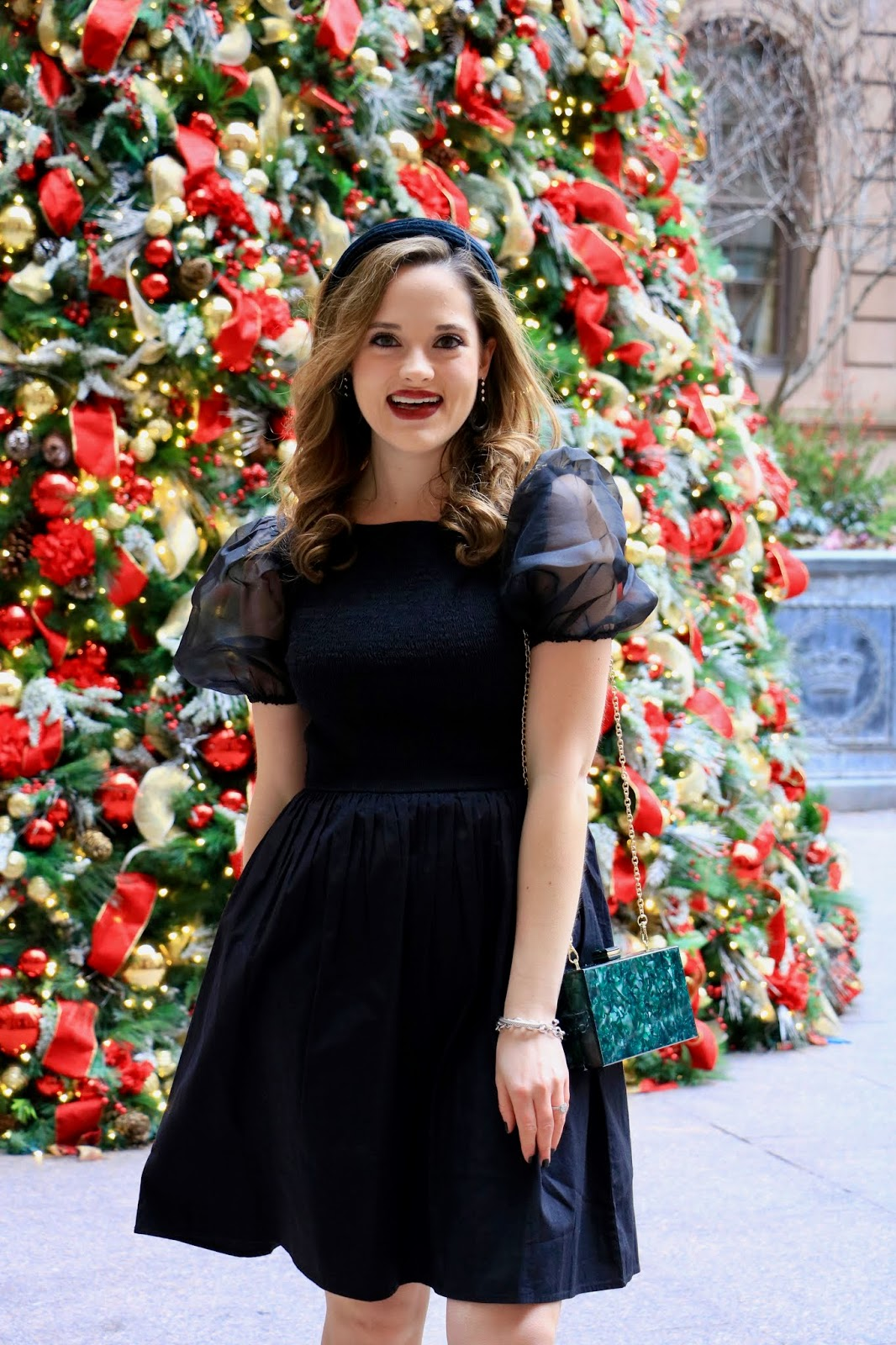 Nyc fashion blogger Kathleen Harper in front of the Lotte New York Palace Christmas tree.