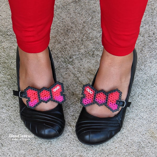 Perler beads melted into darling little bows and attached to shoe clips and attached to black maryjanes