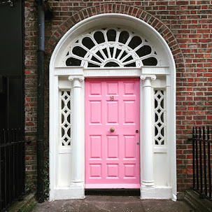 Pink Dublin Door behind Foley's Pub