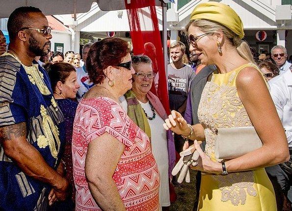 Queen Maxima wore Natan dress, Natan pumps and carres Natan clutch at Saba Island' Saba day celebrations