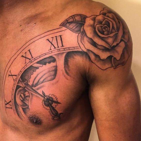 Rose tattoo on shoulder for men