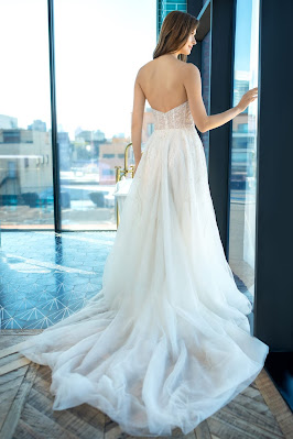 Enaura Bridal Strapless a-line Bridal Dress with beaded throughout Back Design