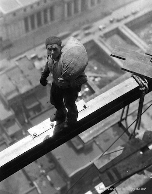 A worker on beam of building at 40 Wall Street, 1930