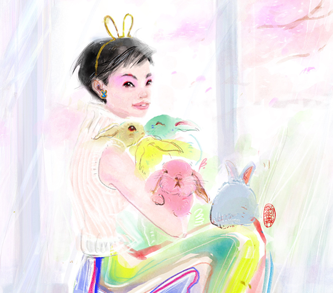 Asian Woman sitting in front of the window at home, holding 5 colour Ester Rabbits during Covid Pandemic Quarantine. Dressing in Rainbow stripes long robe