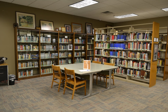 library room featuring South Dakota resources (books) and art.