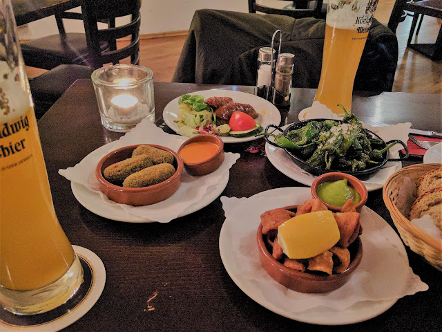 Some tapas from this restaurant: pimentos padrón, croquetas, etc.