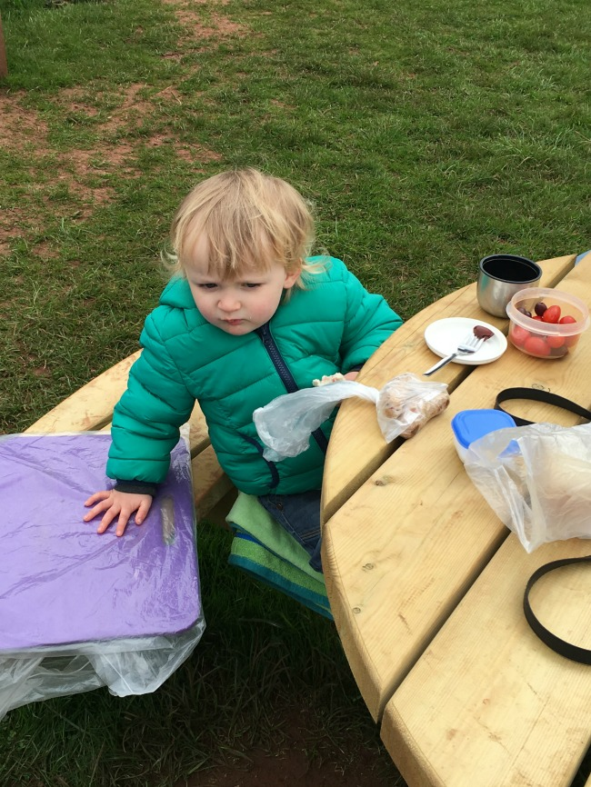 toddler at picnic table