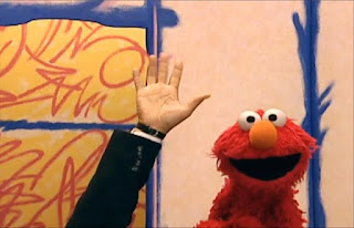 Elmo opens the door and a hand comes in for interview. Sesame Street Elmo's World Hands Interview